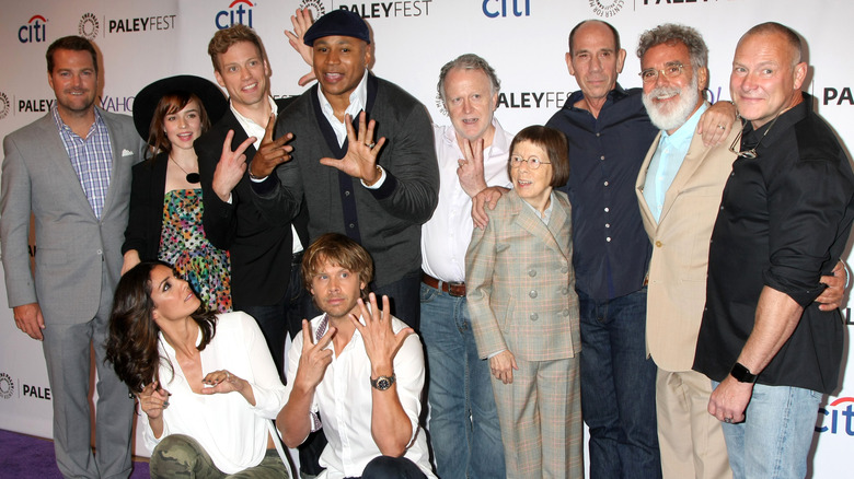 The cast of NCIS: LA poses at an event