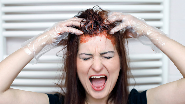 Woman dyeing her own hair