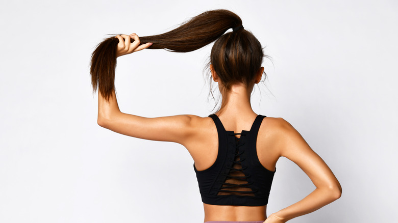 Woman holding her ponytail