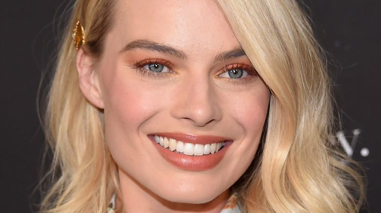 Margot Robbie smiling for the camera