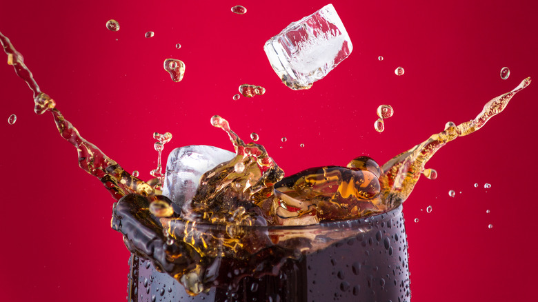 glass of Coca-Cola with ice