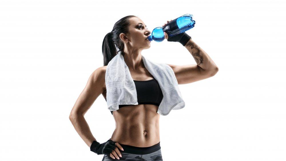 Woman drinking sports drink