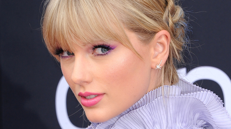 Taylor Swift wears violet with her hair up