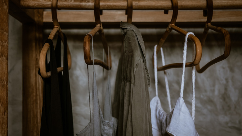 Rustic hangers with clothing