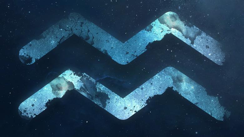 Aquarius symbol floating in the night sky