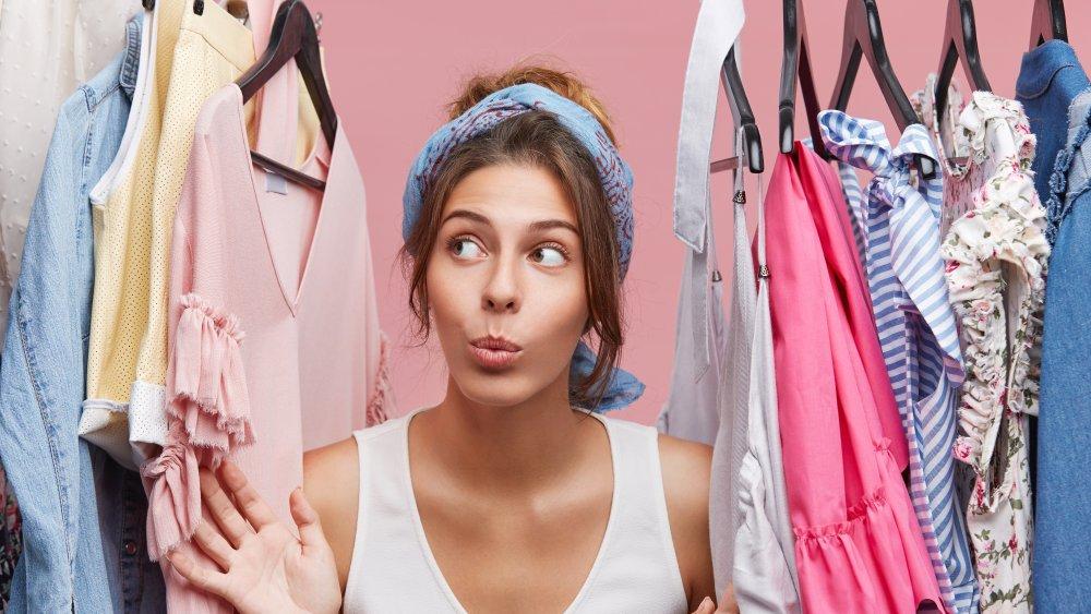 woman looking at clothes closet