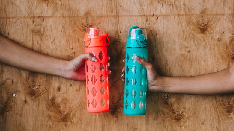 Women holding reusable water bottles