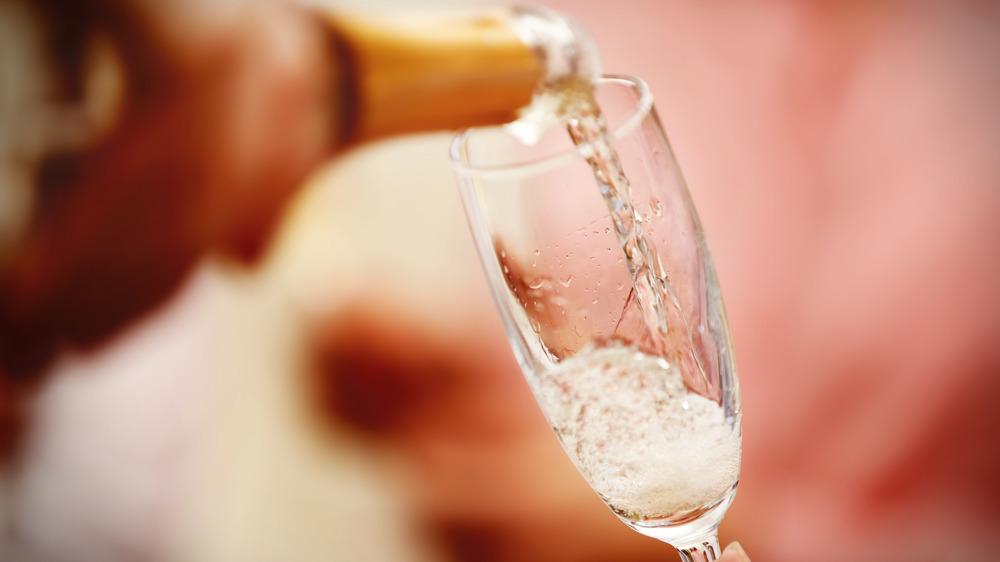 Champagne being poured into a glass