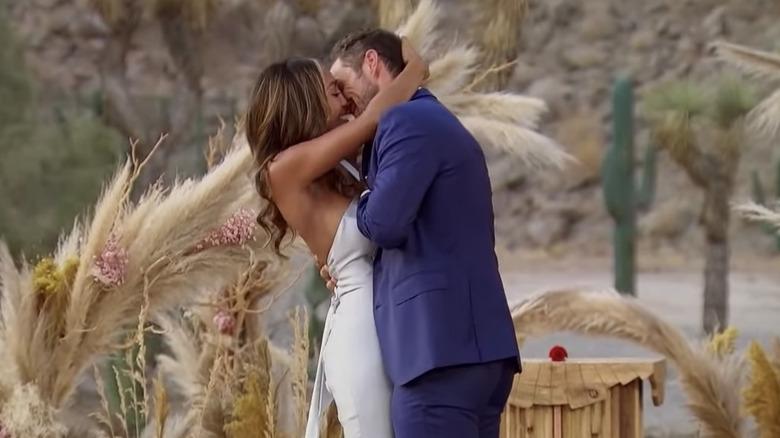 Zac and Tayshia kissing during proposal